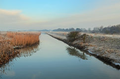 Winter River. Frost and mist on a river in winter Stock Photos