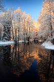 Winter river golden sunset. Winter river with golden sunset reflection Royalty Free Stock Images