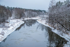 Winter river with ice flowing. In moody daytime Royalty Free Stock Photo