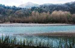 Winter river landscape - floodwater receding Royalty Free Stock Photography
