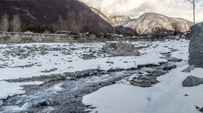 Winter river landscape. Snow covered stream at the mountains of Azerbaijan. Caucasus Royalty Free Stock Images