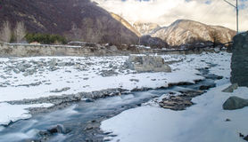 Winter river landscape. Snow covered stream at the mountains of Azerbaijan. Caucasus Stock Photos