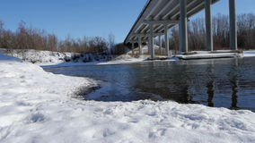 Winter river with open water under the bridge stock footage