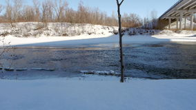 Winter river with open water under the bridge stock video footage