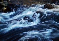 Winter river rapids. Nature seasonal background winter river rapids Royalty Free Stock Photo
