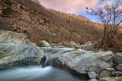 Winter river with rocks Stock Image