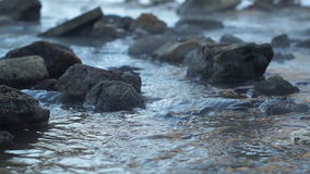 Winter river with stones and steaming water. Steaming water in the rapids of winter river stock footage
