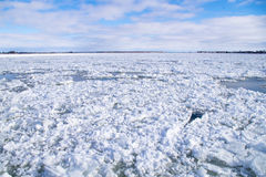 Winter river water with floating ice. Cold, Saint-Lawrence river water with floating ice chunks between Saint-Ignace-de-Loyola and Sorel-Tracy, Québec, Canada Royalty Free Stock Photos