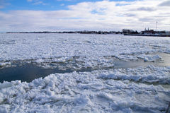 Winter river water with floating ice. Cold, Saint-Lawrence river water with floating ice chunks between Saint-Ignace-de-Loyola and Sorel-Tracy, Québec, Canada Royalty Free Stock Images