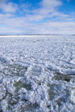 Winter river water with floating ice. Cold, Saint-Lawrence river water with floating ice chunks between Saint-Ignace-de-Loyola and Sorel-Tracy, Québec, Canada Royalty Free Stock Photo
