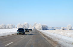 Winter road. Three cars driving on a winter road royalty free stock photos