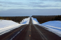 Winter Road. A straight section of a winter highway in Wisconsin Stock Photography