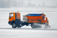 Winter Road. Truck deicing a road in winter Stock Images