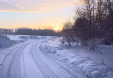Winter road with blue snow at sunrise royalty free stock photos