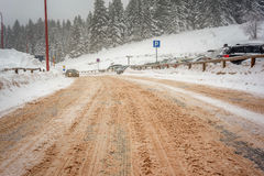 Winter road with cars and fog Royalty Free Stock Images