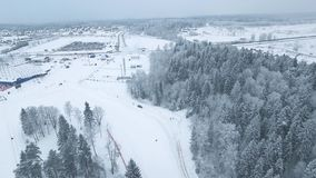 Winter Road Covered with Snow. Aerial shot of winter road, trees and bushes covered with snow stock video