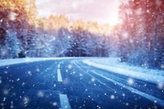 Winter road, covered with snow on sunny day stock photography