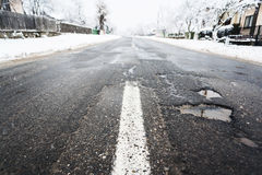 Winter road damage. Seen from low point Stock Images