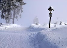 Winter road with directional signs Stock Images