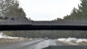 Winter road. Dirty windshield stock video footage