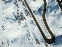 Winter road drone shot of access to the resort. Drone shot of road access to winter resort in French Alps stock images