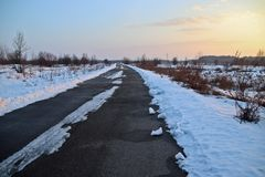 Winter road in February through the snow-covered steppe royalty free stock images