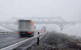 Winter on the road. Winter and fog on Norwegian freeway Royalty Free Stock Photography