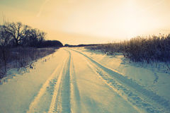 Winter road forest field landscape Royalty Free Stock Images