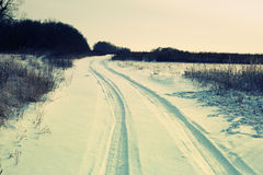 Winter road forest field landscape Royalty Free Stock Photos