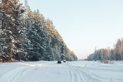 Winter road and forest Royalty Free Stock Photography
