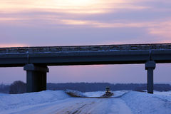 Winter road and highway on the bridge against sunset Stock Images