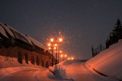 Winter road and lampposts,night landscape. stock image