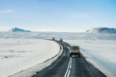 Winter road landscape, with a cars driving on highway in Iceland Royalty Free Stock Photos