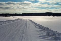 Winter road in Latvia, Europe. Royalty Free Stock Image