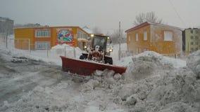 Winter road maintenance: Front End Wheel Loader removes snow from road to kindergarten, interquarter driveways. PETROPAVLOVSK KAMCHATSKY CITY, KAMCHATKA stock video
