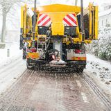 Winter road maintenance truck spreading salt stock photography