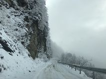 Winter road in a mountain Stock Image