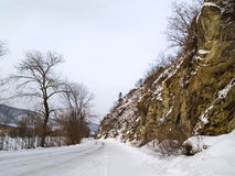 Winter road at a mountain slope Royalty Free Stock Photo