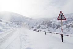 Winter road in the mountains Stock Image