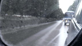Winter road. Movement of cars stock video footage