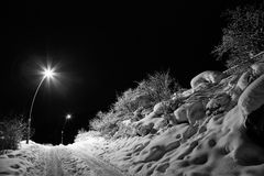 Winter road at night, illuminated by lanterns Stock Images