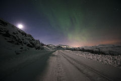 Winter road with northern light Stock Photography