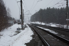 Winter road. Winter raildoad with flying snow Royalty Free Stock Images