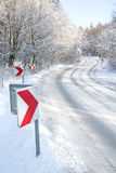 Winter road with red direction Stock Images