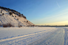 Winter road on the river under the mountain. Landscape. The Eastern Siberia. Royalty Free Stock Photo