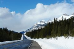 winter road in rocky mountains Stock Photos