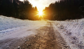Winter road in rural areas at sunset Stock Image