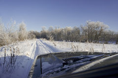 Winter road scenery. In a frozen forest Stock Photo