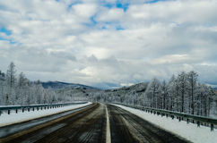 Winter road in Siberia Stock Photo