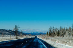 Winter road in Siberia Stock Image